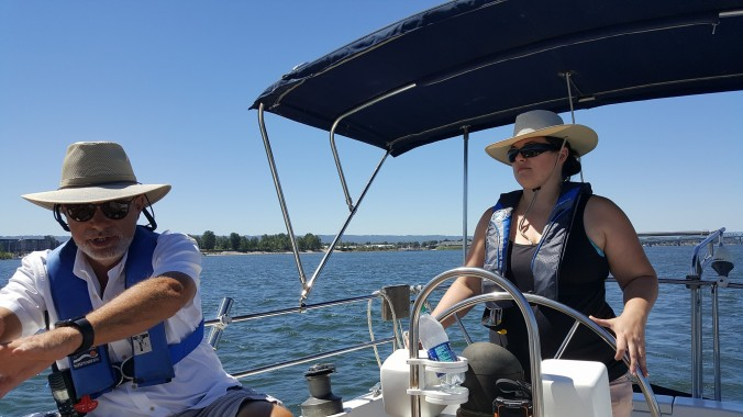 Captain Stephen coaching with Rachel at the helm last summer aboard the sailboat Mosaic