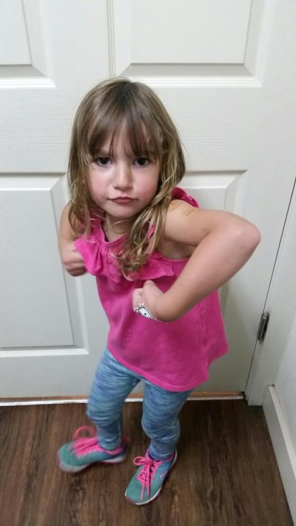 Boat kid shows off muscles after getting vaccines