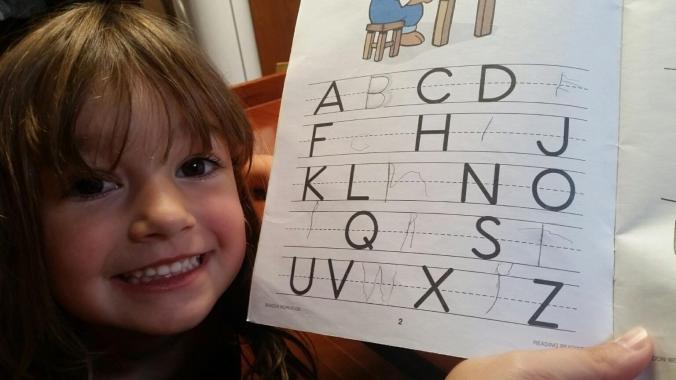 Boat kid shows off her school work