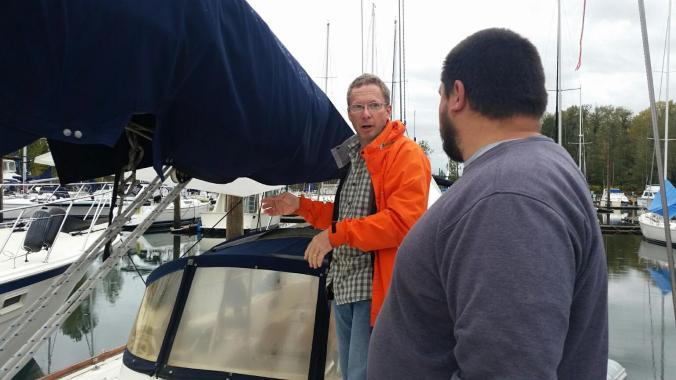 Jamie explains rigging a preventer on the boom aboard our sailboat Mosaic.