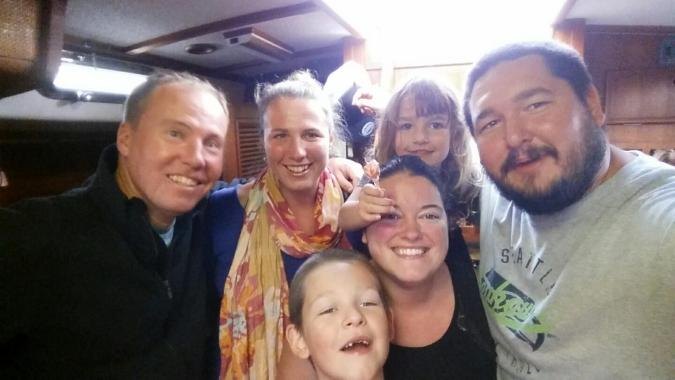 Adventure Adrift crew and Mosaic Voyage family pose for selfie aboard the sailboat SV Mosaic in Portland OR.