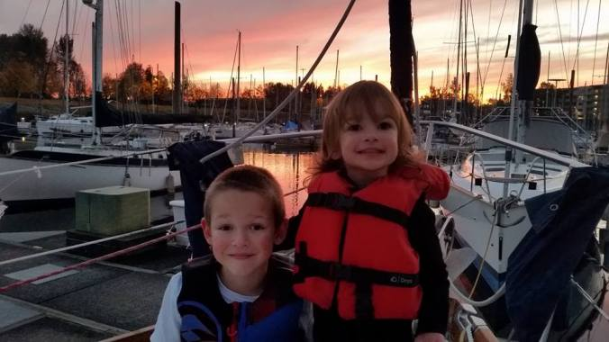 Two kids living aboard a sailboat with their family.