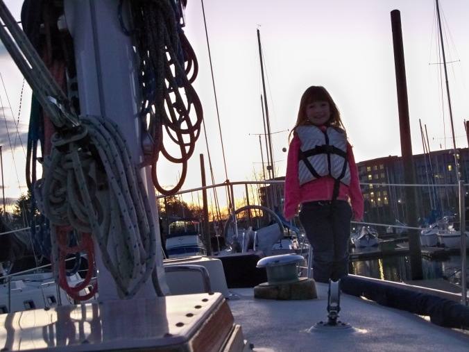 Kali hangs out on the foredeck one evening, enjoying a lovely March sunset