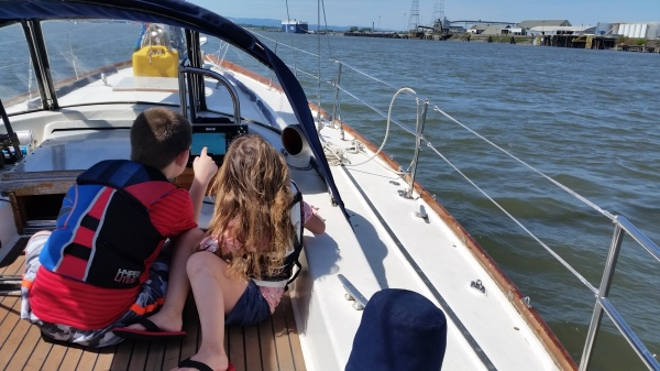 Boat kids learning to use our chart plotters