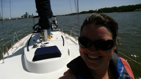 Selfie on the bow of the sailboat as we head downriver