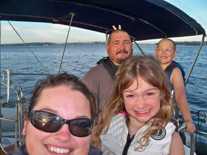 Family sailing from Seattle to Blake Island Marine State Park