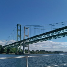 Sailing under the Tacoma Narrows bridge on our Fuji 40 sailboat Mosaic