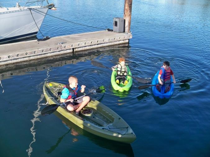 Kids of Fisherman Bay exploring on their kayaks